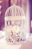 Birdcage with flowers Stock Images