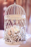 Birdcage with flowers. Wedding decoration Stock Photo