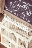 Birdcage for notes Royalty Free Stock Image