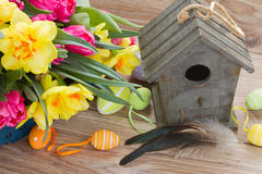 Birdcage with spring flowers Stock Image