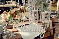 Birdcage. Still glass vases and a white bird cage and the inscription Monday Stock Images