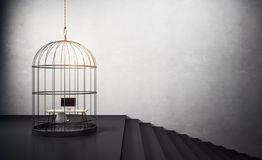 Birdcage with workplace and stairs. Birdcage with workplace ine and black stairs at concrete wall background. 3d rendering Stock Photography