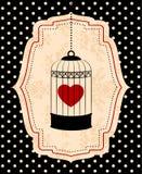 Birdcages y corazón rojo Foto de archivo libre de regalías