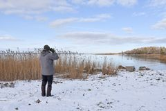 Birder by a bay in winter season. At the swedish island Oland in the Baltic Sea royalty free stock image