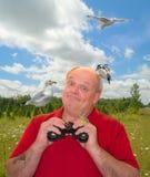 Birder Birding som Fågel-Håller ögonen på Arkivbild