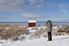 Birder by the coast in winter season. Male birder by the coast in winter season at the swedish island Oland stock images