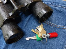 Birder Things. Binoculars, bird caller and blue jeans. Things birders use Royalty Free Stock Photo