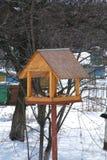 Birdfeeder. In a winter garden Royalty Free Stock Photography