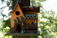 Birdhouse. Small birdhouse on the backgrounds of trees Stock Photos