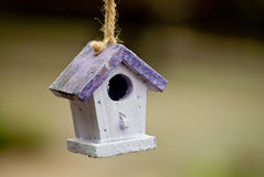 Birdhouse. Beautiful nest box hanging on a tree waiting for his resident Stock Image