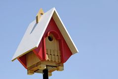 Birdhouse. A new birdhouse with a white roof Royalty Free Stock Image