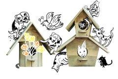 Birdhouse with animal cartoon Royalty Free Stock Photography