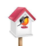 Birdhouse with bird. Isolated on white Stock Photography