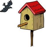 Birdhouse and bird Stock Image