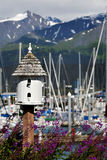 Birdhouse and Busy Harbor in Alaska Stock Image