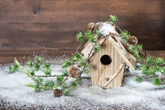 Birdhouse and christmas tree brunch decoration Stock Images