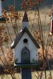 Birdhouse church. Birdhouse with steeple Stock Photo