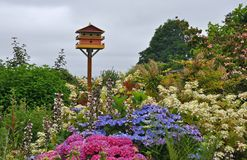 Birdhouse in colorful spring garden royalty free stock image