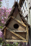 Birdhouse on a fence Royalty Free Stock Images