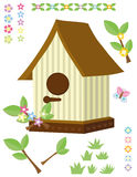 Birdhouse, flowers, grass and butterfly Stock Photography