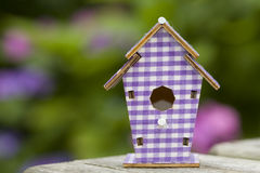 Birdhouse in the garden Stock Images