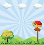 A birdhouse at the hilltop with an arrowboard Royalty Free Stock Photo