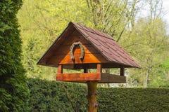 Birdhouse with horseshoe. Wooden birdhouse with iron horseshoe royalty free stock images