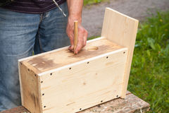 Free Birdhouse Made Of Wood, Carpenter Works With Drill Royalty Free Stock Images - 67037819