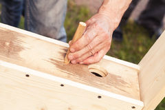 Birdhouse made of wood is under construction Royalty Free Stock Photo