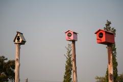 Birdhouse. The multi-color birdhouse same as the village stock photo