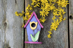 Birdhouse on old wooden fence Royalty Free Stock Photography