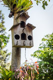 Birdhouse. Old wooden birdhouse hanging on the tree Royalty Free Stock Photo