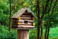 Birdhouse in the park. Wooden birdhouse on a tree stump in the autumn park Stock Photography