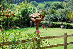 Birdhouse of pastoral garden in Cotswolds, England Royalty Free Stock Photos