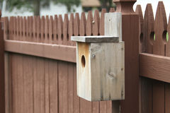 Birdhouse on a picket fence Stock Photos