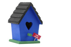 Birdhouse For Sale. Birdhouse with a for sale sign on a white background Royalty Free Stock Image