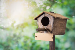 Birdhouse with signboard Royalty Free Stock Image