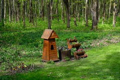 Birdhouse and some flowers - Tsaritsyno park, Moscow, Russia. Birdhouse and some flowers near the walkway in Tsaritsyno park, Moscow, Russia Stock Image