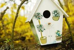 Birdhouse in tree. A quaint birdhouse in a tree stock photos