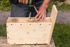 Birdhouse is under construction, carpenter works Royalty Free Stock Photo