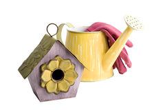 Birdhouse with Watering Can Royalty Free Stock Photos