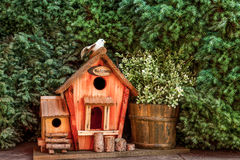 Birdhouse. A welcome birdhouse whit a bird on the roof Royalty Free Stock Images