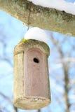 Birdhouse in winter stock photography