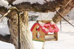 Birdhouse in winter outside royalty free stock photo