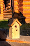 Birdhouse. Wood illuminated by the sun Royalty Free Stock Photo