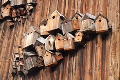 Birdhouses. On the barn in the village Germany Stock Photos
