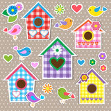 Birdhouses,birds and flowers Royalty Free Stock Photos