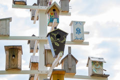 Birdhouses. Lots of birdhouses as multi-storey buildings Stock Photos