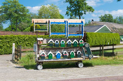 Birdhouses for sale. Cart with birdhouses painted in the traditional colors of staphorst, netherlands Royalty Free Stock Image