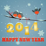 Birdies Happy new year 2014. Little birdies on branch and snowy 2014 happy new year text Stock Photos